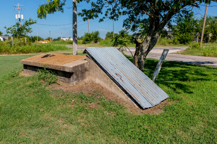 older storm shelter in residential yard
