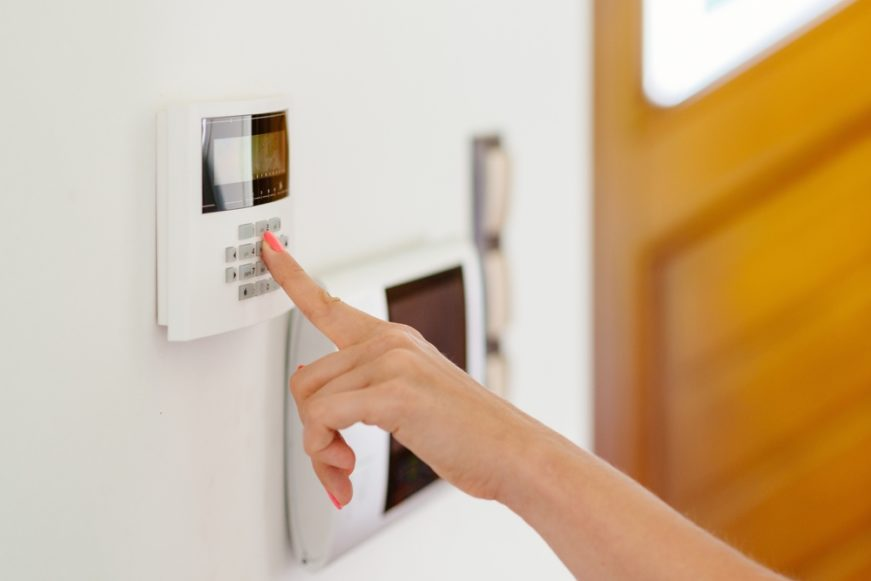 Woman setting up security system