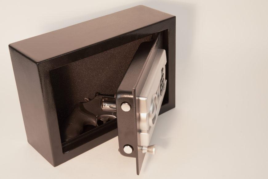 hand gun inside of a gun safe