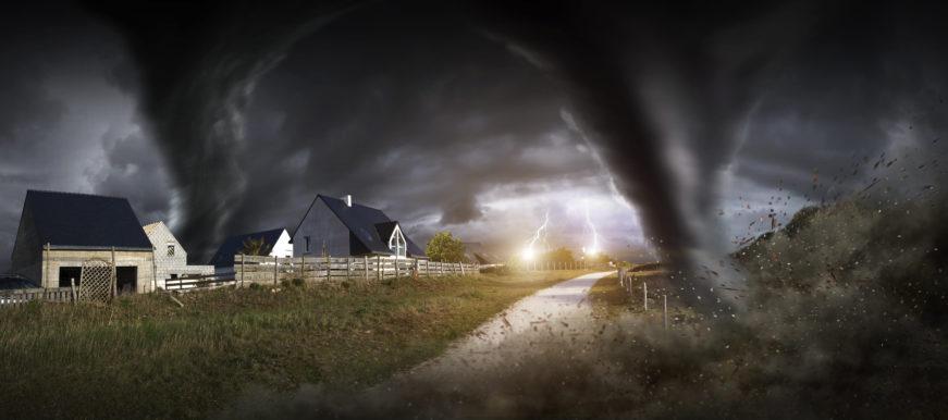 Large tornado destroying landscape and city