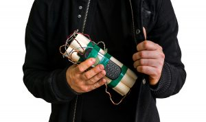 Terrorist in a holding a homemade bomb