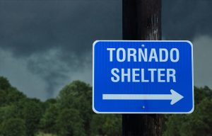 Tornado shelter sign with a storm forming in the background